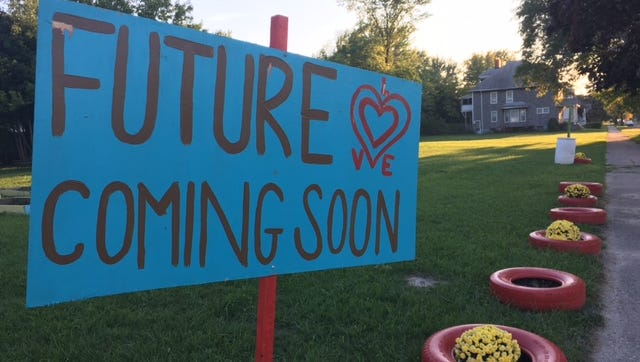 "A ""future is coming soon"" sign at Avalon Village in Highland Park."