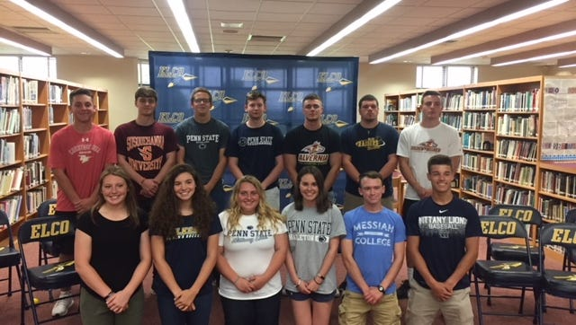 This group of 13 Elco High School student-athletes announce their college choices on Wednesday. They are, front row, from left, Amaya Phillips, Emily Bidelspach, Haley Sherk, Kelsie Salem, Ryan McAllister, and Clay Hain. Back row, Ryan Woelfling, Seth Noll, Adam Johnson, Blake Weary, Joe Ginder, Travis Weaver,  and Jeff Lorah.