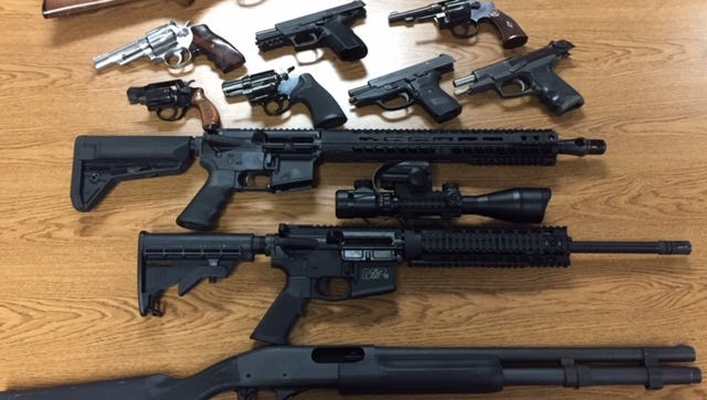 After Jacob Baird's arrest, officers seized these firearms,  including two AR-15 rifles, as well as about 3,000 rounds of ammunition and several high-capacity magazines. His probation banned him from possessing or owning any firearms or ammunition, authorities said.