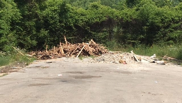 Refuse piled at a the end of a road in North Memphis where illegal dumping often occurs.