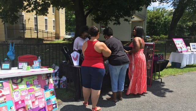 Women buy crafts from a vendor during Salisbury's Juneteenth celebration June 16, 2018.