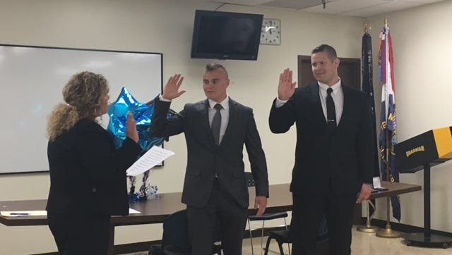 Lori Cope, safety-service director for the City of Mansfield, Tuesday swore in two new police officers, Josh Adamescu and Jacob Oblak.