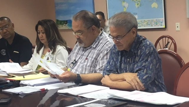 From left, Guam Memorial Hospital nursing director Zennia Pecina, Administrator PeterJohn Camacho, and Associate Administrator Dr. Vince Duenas, review documents during a briefing Monday afternoon at the hospital.