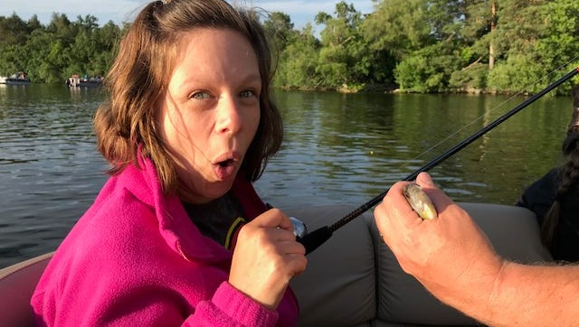 Participant Emily Donner was in awe of the fish that was caught during the YMCA at Pabst Farms' Special Program's fishing night June 25 on Okauchee Lake.