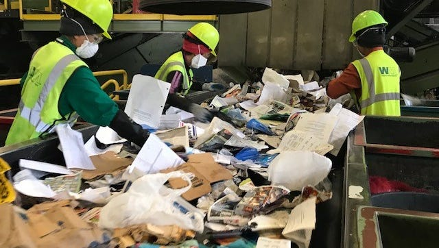 Recycling collected from Kitsap County by Waste Management is transported to the WM JMK Fibers facility at the Port of Tacoma to be sorted. It's had to slow down the sorting line and hire 24 new staffers to lower recycling contamination rates at market.