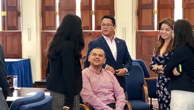 Senators share a light moment before the start of a morning session on July 17, 2018, to greet Sen. Dennis Rodriguez, seated, on his birthday. Vice Speaker Therese Terlaje, Sens. Wil Castro, Louise Muna and Regine Biscoe Lee joined their colleagues in singing a birthday song.
