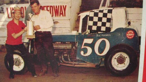 "Bobby Hersh, left, and Bud Folkenroth, driver of #50, pose with their trophy at Lincoln Speedway in western York County. ""I only wish I had the thousands (of photos) I snapped while working for King's Racing Photos from 1960 to1965,"" Glen Flinchbaugh wrote. ""Dirt track racing is near and dear to many of us, and I have many fond memories."""
