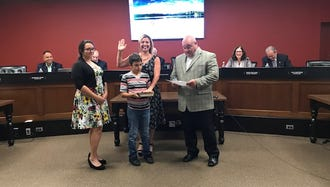 Jennifer Polidori (center) is sworn in as a Pompton Lakes councilperson on July 18, 2018 by Mayor Michael Serra (right).