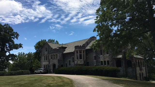 Owners of the Barrett Estate mansion in Hyde Park, pictured here July 19, 2018, say reports they plan to tear it down are false.