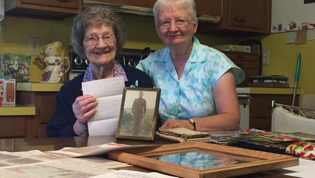 Anna Albert, left, is the sister of Corporal Andrew Boyer, who was missing and presumed dead in the Korean War. She holds the last letter he sent her, as well as his picture. Her daughter, Mary College of Annville, wrote a letter to President Donald  Trump prior to his visit to North Korea, encouraging him to ask that country to return US soldier remains. The first remains were returned to Hawaii Aug. 1.