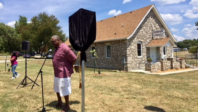 Wes Pratt, who grew up in Springfield, spoke Saturday before helping to unveil a rendering of the first historic marker of the African-American Heritage Trail.