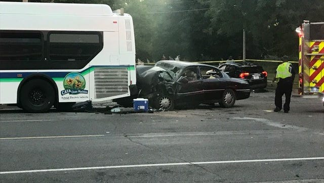 Two people were killed in a crash involving two passenger vehicles and a Capital Area Transportation Authority bus on Friday evening, Aug. 10, 2018, police said.