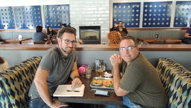 From the Hearth owner John Dix, right, sits with Redding filmmaker Matt Thayer at the Market Street restaurant.