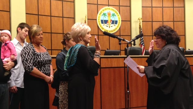Mary Fischer being sworn in to the Lee County School Board.