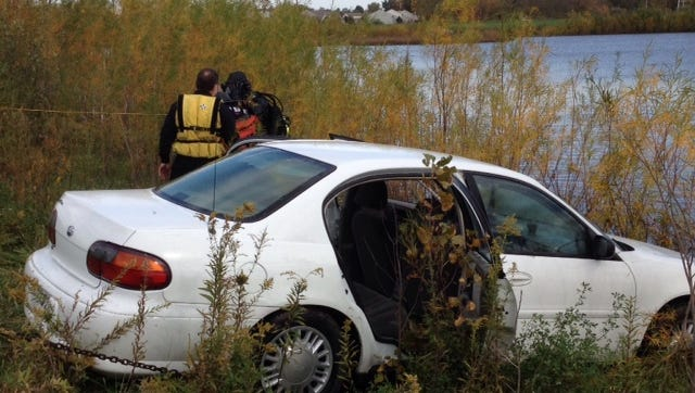 A car was found submerged in a pond Friday, Oct. 17, 2014.