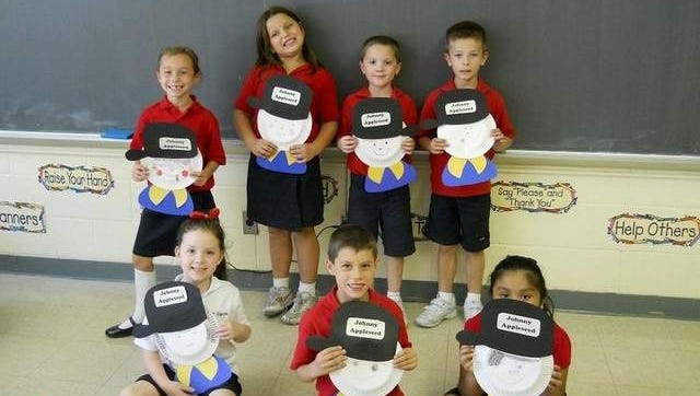 Photo is of 1st Grade Students with their Johnny Appleseed project.