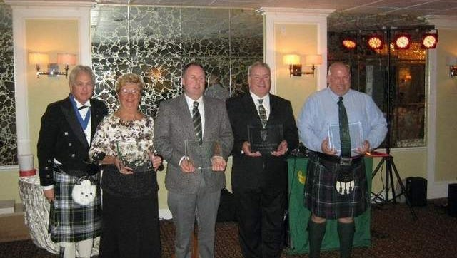 Division #32 President congratulates honorees Peggy Carroll, Tim Eason, Dan Reilly and Paul Lee.