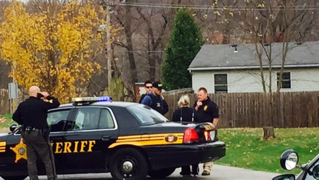 Butler police Chief Brian Darby talks with family members on College Street regarding a domestic dispute Tuesday morning.