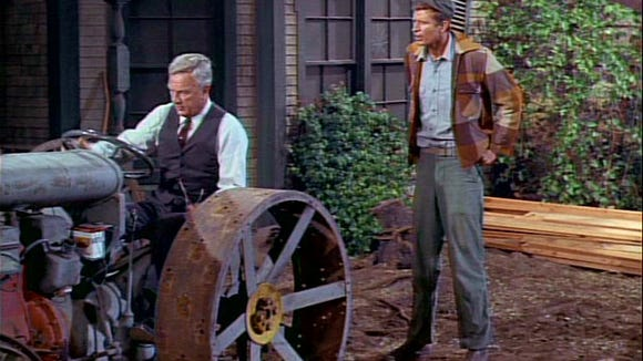 "New York lawyer Oliver Wendell Douglas (Eddie Albert), left, doesn't change his wardrobe when he takes over a farm in the absurdist comedy ""Green Acres."""