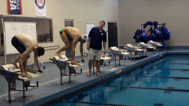 Swimmer Erik Nieman trains with Ryan Lochte with coach Dave Marsh leading the workout Tuesday. Nieman met Lochte through Make-A-Wish.
