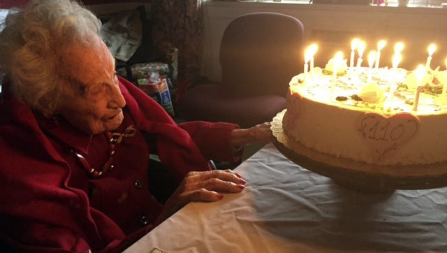 In this Saturday photo provided by Mary-Kate Mele, Emily Tremonti celebrates her 110th birthday in Fairfield, Conn. Tremonti grew up with four sisters in Mount Vernon, N.Y. One also lived to 100.