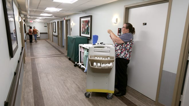 Judi Barry, an LPN, prepares medication for a patient at Creekview Nursing Hime in Gates.  The facility has gone through renovations and upgrades.