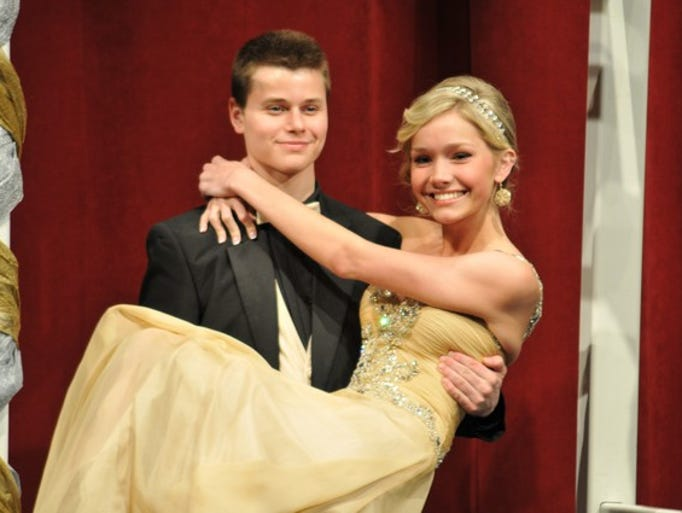 Ben Zimring lifts his prom date Emma Nelson durng the grand march on Saturday, April 26, at St. Cloud Tech High School.