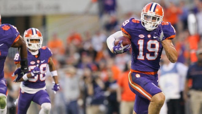 Clemson safety Tanner Muse returns an interception for a 64-yard touchdown against Syracuse on Nov. 5, 2016 at Memorial Stadium.