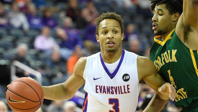 Evansville's Jaylon Brown drives toward the basket guarded by Norfolk State's Micah Gross when the Aces played the Norfolk State Spartans at the Ford Center in Evansville on Wednesday.