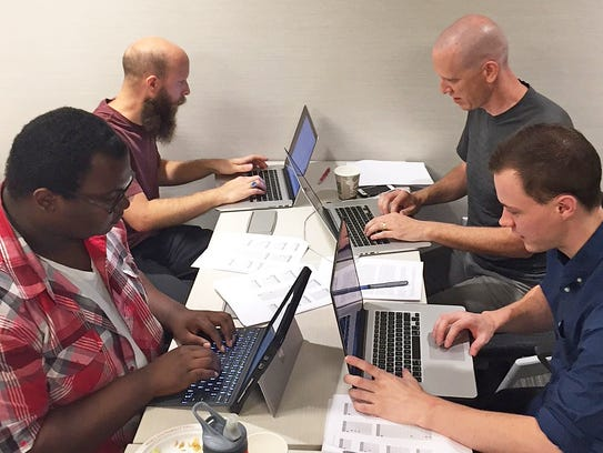 Participants shown hard at work at Coding for a Cause.