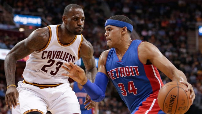 Detroit Pistons'' Tobias Harris (34) drives past Cleveland Cavaliers' LeBron James (23) in the second half of an NBA basketball game Monday, Feb. 22, 2016, in Cleveland.
