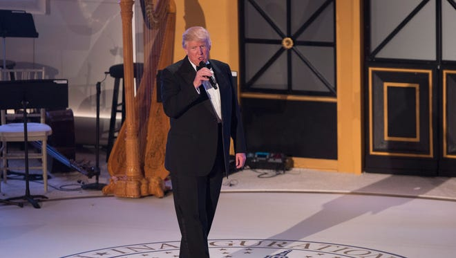epa05732740 US President-elect Donald J. Trump speaks during the Candlelight Dinner at Union Station, one day before Trump is sworn in as the 45th President of the United States in Washington, DC, USA, 19 January 2017. Trump won the 08 November 2016 election to become the next US President.  EPA/CHRIS KLEPONIS / POOL