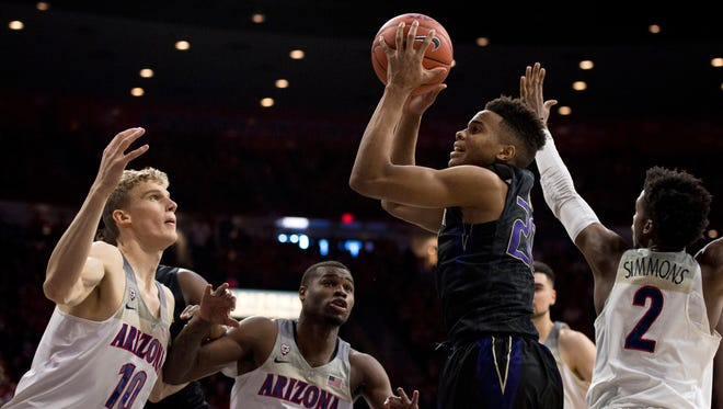 Washington guard Markelle Fultz is surrounded by Arizona defenders as he goes up to shoot in the first half Sunday at McKale Center. Fultz, a freshman, scored a game-high 16 points but shot 8-for-23 from the field.