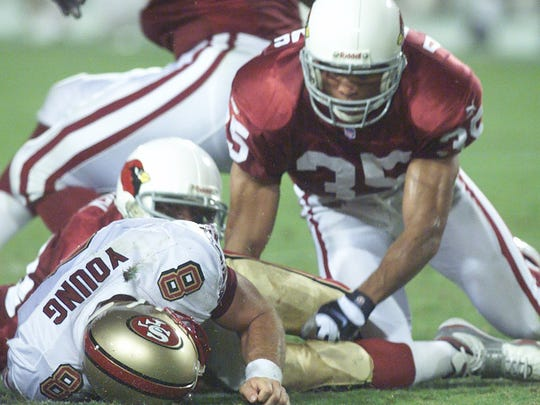 Aeneas Williams hits Steve Young in the first half.