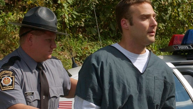 Pennsylvania State police escort Hugo Selenski, right, into his arraignment Monday, Oct. 6, 2003, in Kingston, Pa.