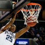 Villanova guard Mikal Bridges (25) dunks during the second half of a second-round NCAA men's college basketball tournament game against Iowa, Sunday, March 20, 2016, in New York. Villanova defeated Iowa 87-68. (AP Photo/Kathy Willens)
