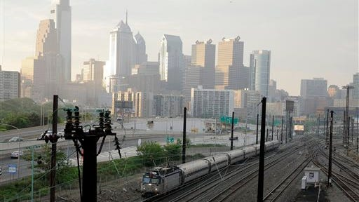 An Amtrak train travels northbound from 30th Street Station on Monday Amtrak's Northeast Corridor trains resumed service Monday following last week's deadly derailment that killed eight people and injured more than 200 others.