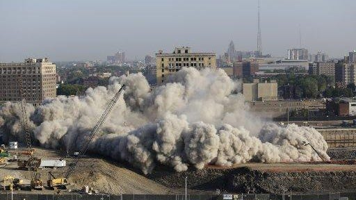 The Park Avenue Hotel, built in 1924, is imploded Saturday July 11, 2015 in Detroit.