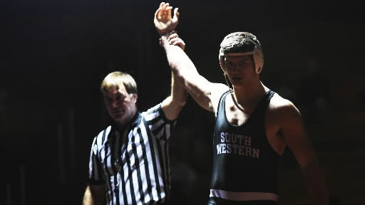 South Western's Seth Janney shown getting his hand raised after a victory against Kennard-Dale this year is one of the YAIAA's top individuals. - (Clare Becker - The Evening Sun)