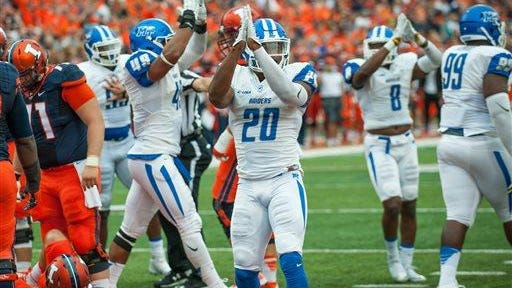 MTSU players signal for a safety after Illinois quarterback Wes Lunt (not pictured) fumbled a snap.