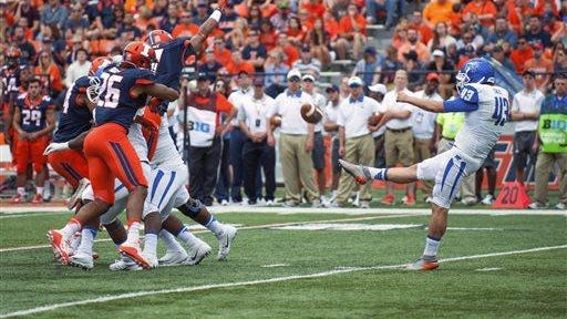 Illinois defensive back Caleb Day (7) blocks a punt by Middle Tennessee punter Trevor Owens (43) during the second quarter Saturday, Sept. 26, 2015, at Memorial Stadium in Champaign, Illinois. The punt was recovered by Illinois in the end zone for a touchdown. Illinois would hold on for the 27-25 victory.