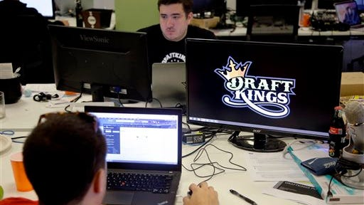 Len Don Diego, marketing manager for content at DraftKings, a daily fantasy sports company, works at his station at the company's offices in Boston. New York's attorney general has sent letters to daily fantasy sports websites DraftKings and FanDuel demanding they turn over details of any investigations into their employees on Tuesday, Oct. 6, 2015.