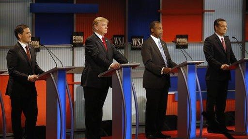 FILE - In this Nov. 10, 2015 file photo, Republican presidential candidate, from left, Sen. Marco Rubio, R-Fla., Donald Trump, Ben Carson and Sen. Ted Cruz, R-Texas, wait before the Republican presidential debate at the Milwaukee Theatre in Milwaukee. The leading Republican candidates for U.S. president are meeting for their first debate in more than a month in the shadow of terrorist attacks that refocused the race on keeping the country safe.
