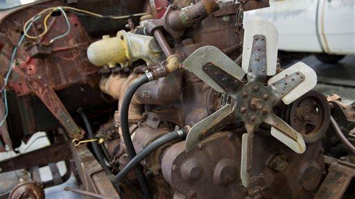 An early Cummins 1939 HB diesel engine sits in the engine bay of an International Harvester truck at the Cummins Historical Restoration garage in Columbus, Thursday, March 24, 2016. Truck owner Owen Hanson, a farmer from South Dakota, donated the engine and the truck to Cummins for its historical collection.