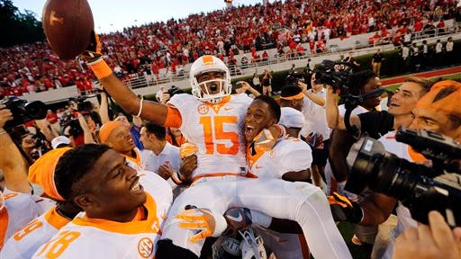 Tennessee wide receiver Jauan Jennings (15) is carried by teammates Kyle Phillips (5) and Charles Mosley (78) after making a last-second touchdown catch to defeat Georgia 34-31 on Oct. 1, 2016, in Athens, Ga.