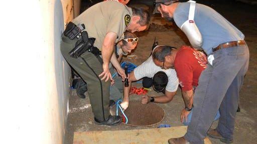 Rescue workers look down a well helping a dog that was trapped on Tuesday in Surgoinsville. A construction worker helping to install solar panels in a field beside an abandoned nuclear reactor in Hawkins County helped rescue the dog that got stuck in a 30-foot hole. Matt Mountie called dispatchers and several agencies responded to help. Working together, they were able to pull the dog, nicknamed Timmy, out safely.