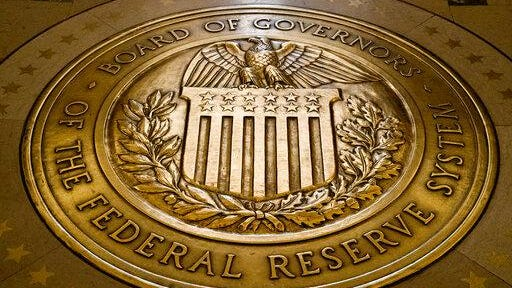 This file photo shows the seal of the Board of Governors of the United States Federal Reserve System in the ground at the Marriner S. Eccles Federal Reserve Board Building in Washington. President Donald Trump says on Twitter he will nominate economists Christopher Waller and Judy Shelton to fill two vacancies on the Federal Reserve Board of Governors.