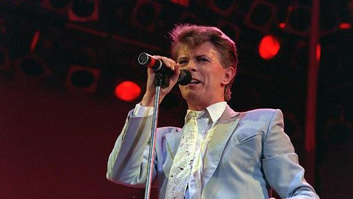 Rock star David Bowie performs on stage at Wembley Stadium on July 13, 1985, in London during the Live Aid famine relief rock concert.