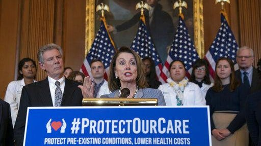 """Speaker of the House Nancy Pelosi, D-Calif., joined at left by Energy and Commerce Committee Chair Frank Pallone, D-N.J., speaks at an event to announce legislation to lower health care costs and protect people with pre-existing medical conditions, at the Capitol in Washington, Tuesday, March 26, 2019. The Democratic action comes after the Trump administration told a federal appeals court that the entire Affordable Care Act, known as """"Obamacare,"""" should be struck down as unconstitutional."""