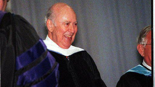 Honorary Degree Recipient Carl Reiner acknowledges the applause of the audience after giving the commencement address at the commencement exercises for the New England Institute of Technology at Brown's Meehan Auditorium in Providence in 2000.
